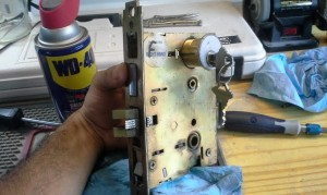 Eagle's locksmith is testing the new lock with the mechanism before installation.
