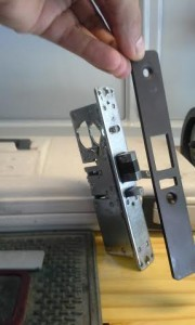Here are the lock mechanism and the new security plate before installation.
